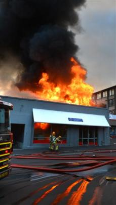 Flames leap high at the central Dunedin digital print and document centre Colortronics yesterday...