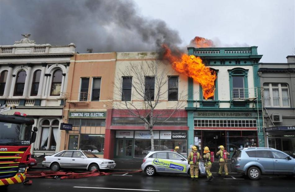Flames leap out of a Princes St, Dunedin, building yesterday. Photos by Craig Baxter, Linda...