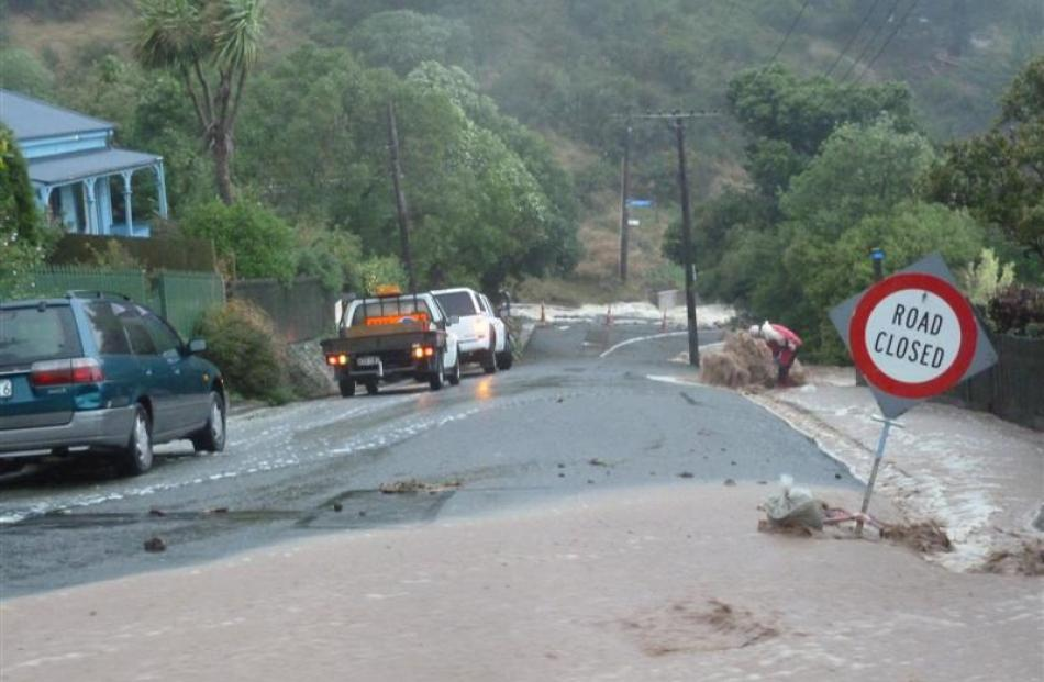 Flooding in Somes Rd, Lyttelton. Photo by Daniel Blake