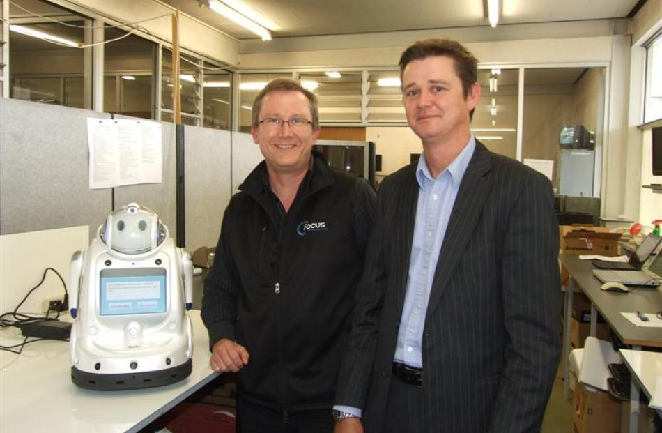 Focus Technology Group senior technician Martin Little (left) and Gore Health Ltd chief executive...