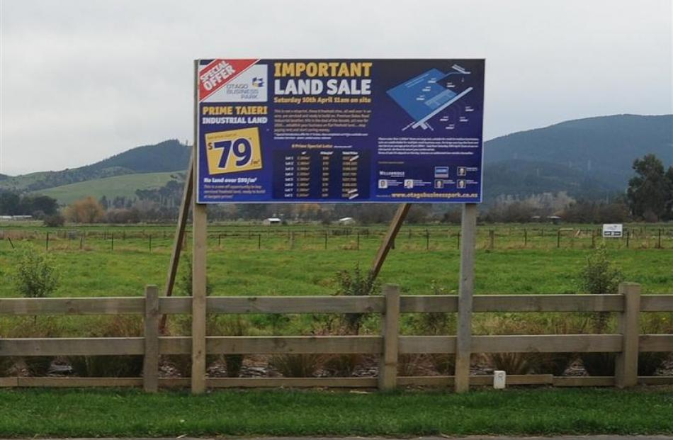 For sale and for lease signs on industrial land on Dukes Rd, near Mosgiel. Photo by Peter McIntosh.