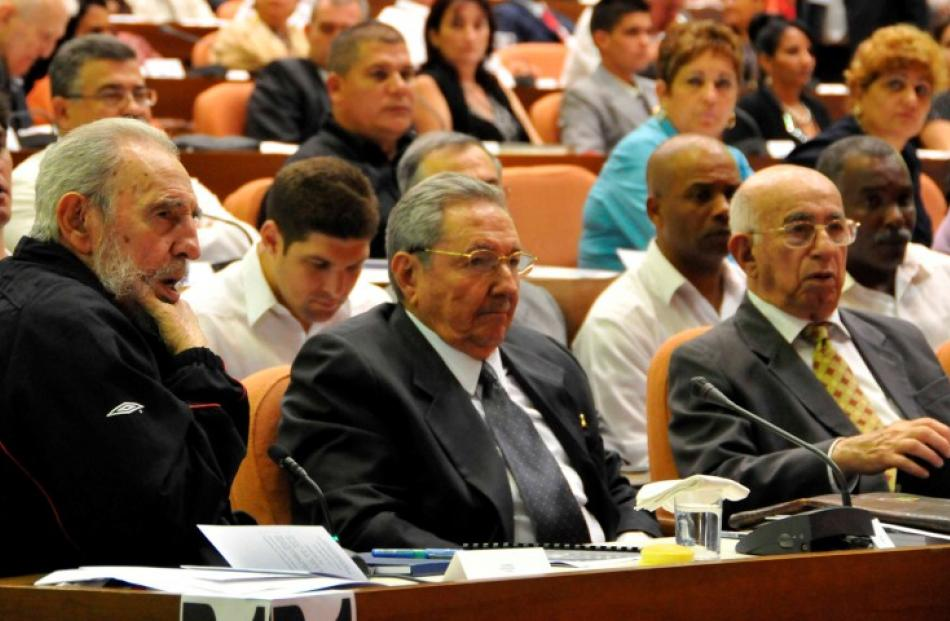 Former Cuban leader Fidel Castro, (L), attends the opening session of the National Assembly of...