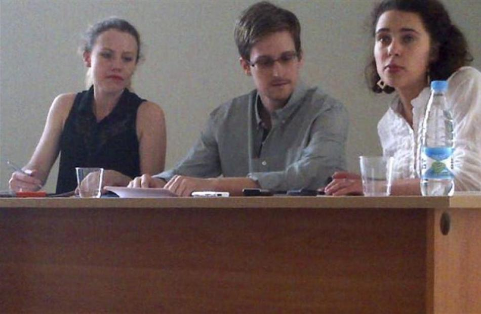 Former intelligence agency contractor Edward Snowden and Sarah Harrison (left), of WikiLeaks,...
