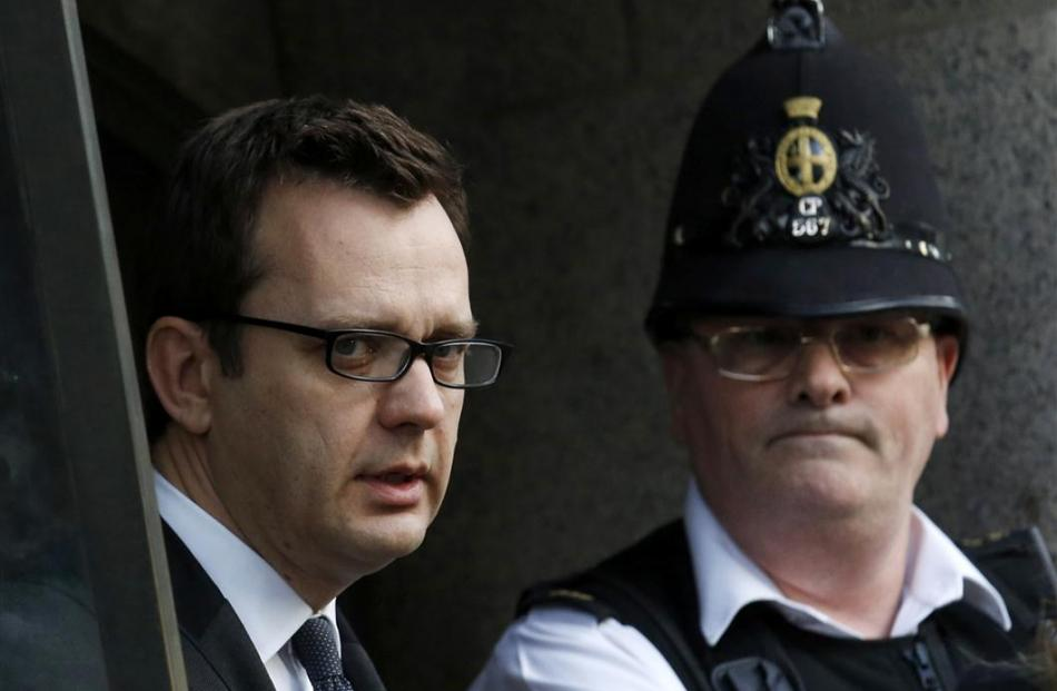 Former News of the World editor Andy Coulson leaves the Old Bailey. REUTERS/Luke MacGregor
