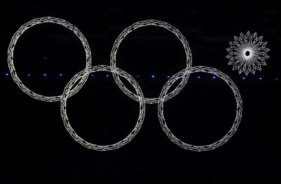 Four out of five Olympic rings are seen lit up during the opening ceremony of the Sochi 2014...
