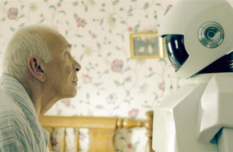 Frank Langella searches for a connection with his UGC-60L home care robot in Robot & Frank. Photo...