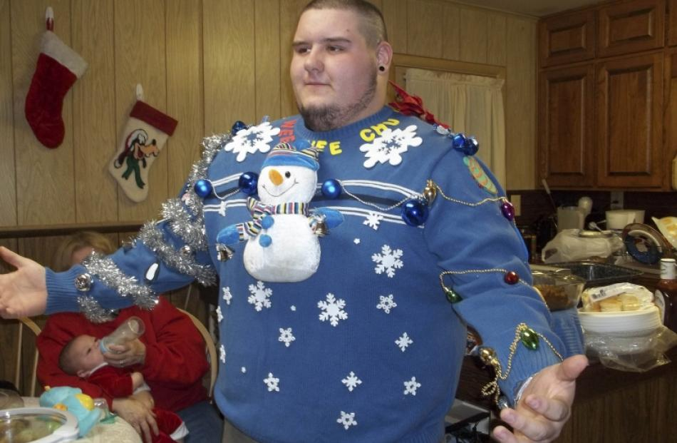 Fred Montana models a fine example of an ugly sweater at the Thrift Town store in Richland, Texas...