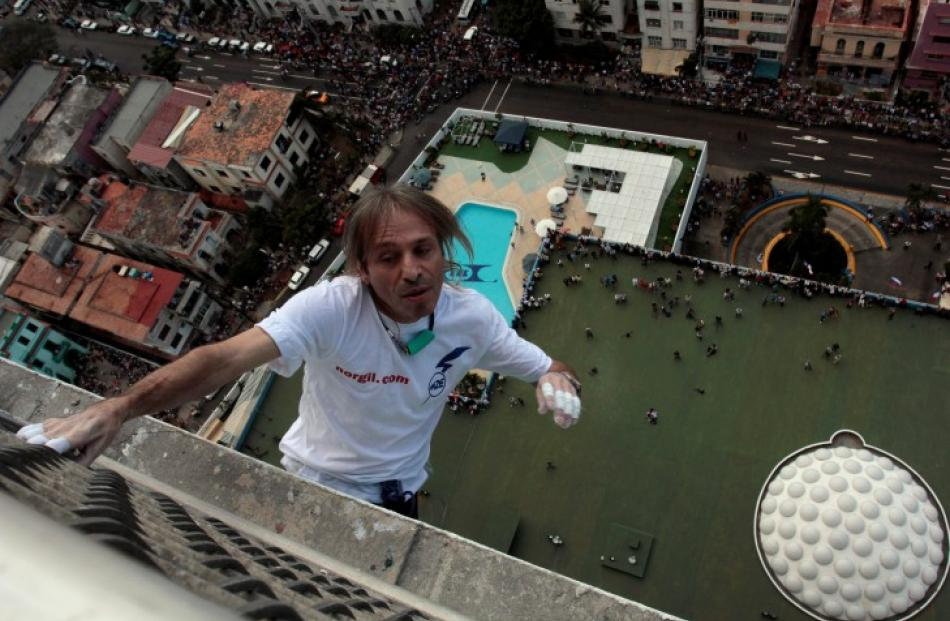 Frenchman Alain Robert climbs the Habana Libre hotel in Havana, Cuba. REUTERS/Stringer
