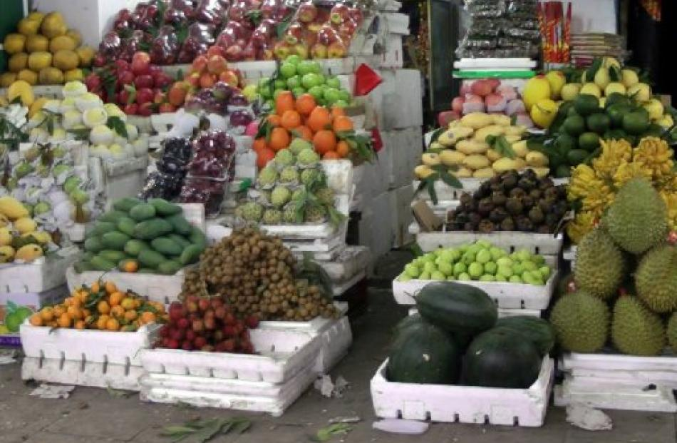 Fresh fruit is piled high in a Hanoi market.