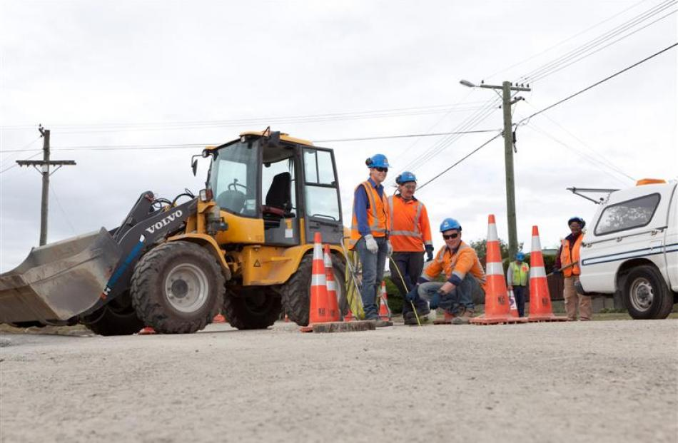 Fulton Hogan staff on site at a job in the garden city. The economies of both Auckland and...