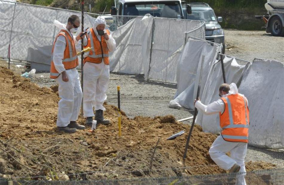 Fulton Hogan staff work on preparing the contaminated site at the former Glendermid Leathers...