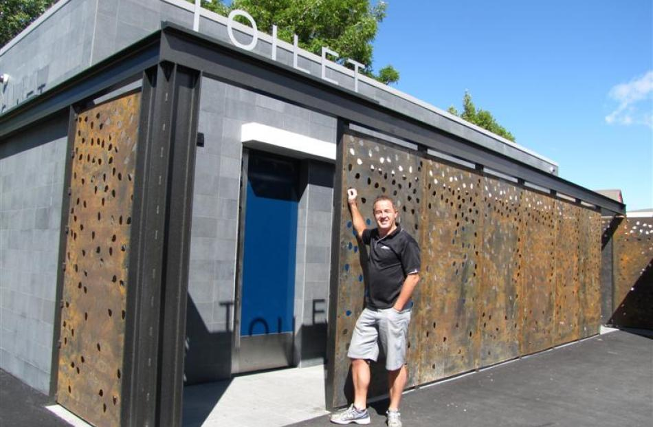 "Gary Anderson checks out the ""flash"" new public toilets in Cromwell. Photo by Sarah Marquet."