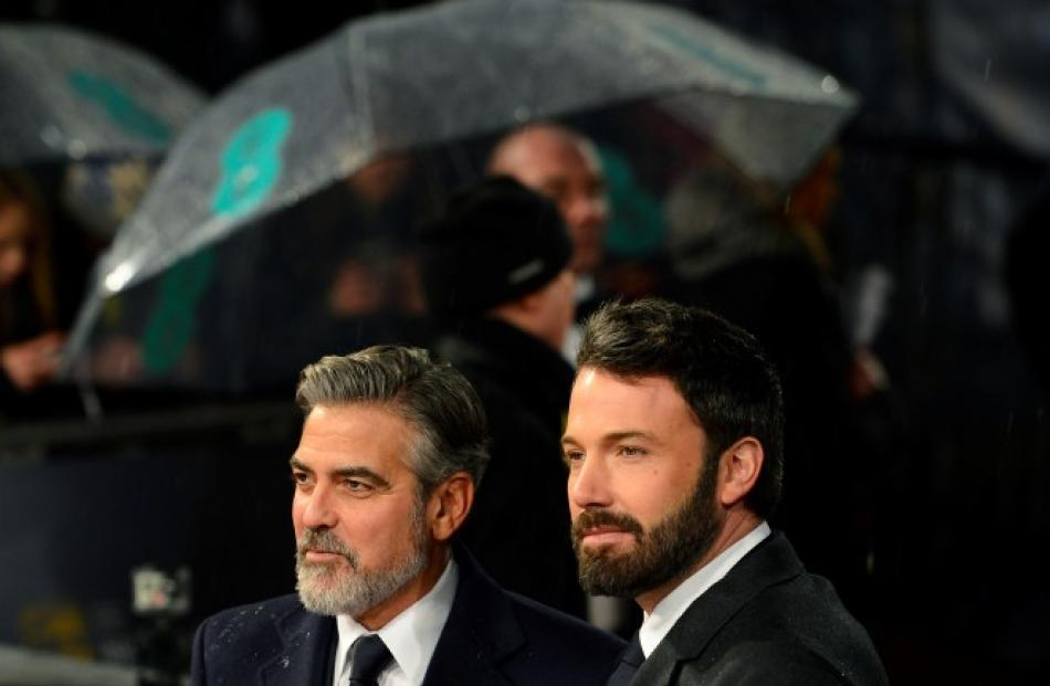 George Clooney (L) and Ben Affleck pose as they arrive for the Bafta awards ceremony at the Royal...