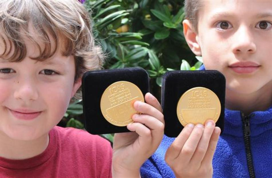 George Street Normal School pupils Paxton Hall (left) and William Scharpf with their gold medals ...