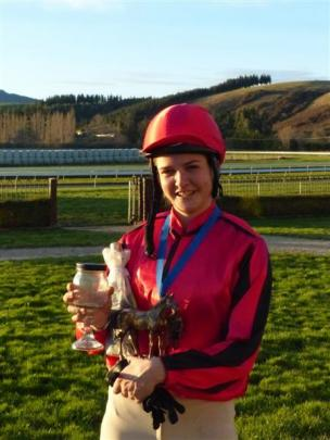 Georgia Sumner-Davis with her spoils after winning the Charity Riders Oaks at Wingatui on Sunday....