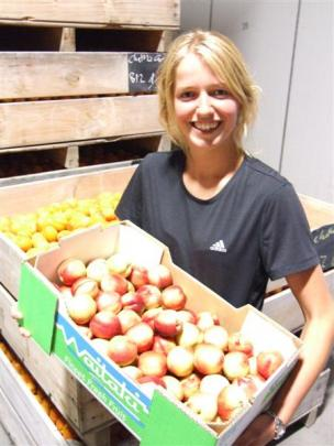 Geraldine Watt shows off a box of nectarines ready for sale. Photos by ODT.