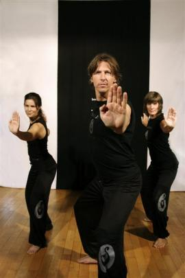 German fitness instructor Bernhard Jakszt (centre) demonstrates an Aroha haka fitness exercise....