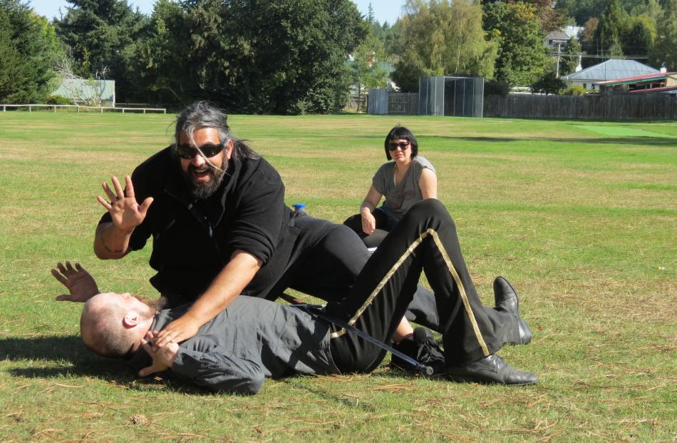 Getting down . . . Auckland Medieval Battle Arts Association captain James Bennett topples Arne...