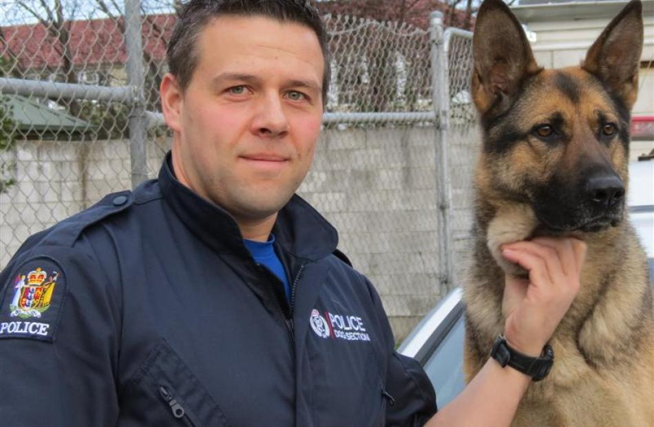 Getting towed along for the ride is one of many things police dog handler Constable Alan Duncan,...