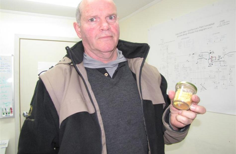 Glass Earth Gold president and chief executive officer Simon Henderson with a 3.4ounces of gold...
