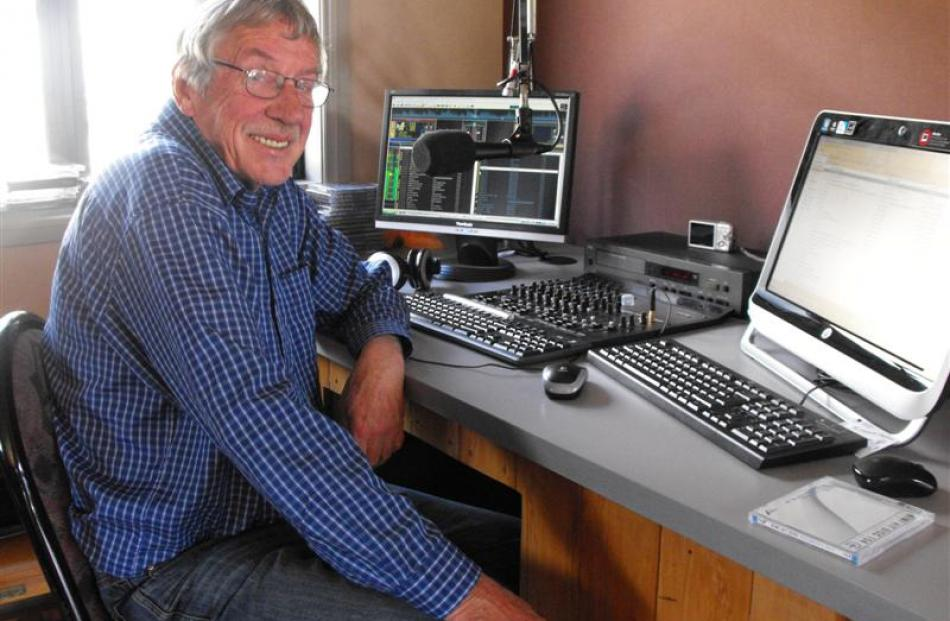 Glenorchy Country Radio broadcaster Chas Drader at his Glenorchy home with his new HP computer...