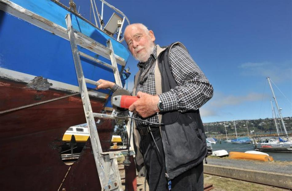 Gordon Caley is able to work on his boat after having both hips replaced. Photo by Gregor...