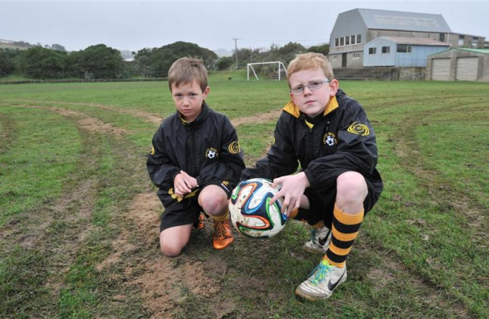 Grants Braes Football Club junior players Dylan Mitchell (8, left) and Connor Cooper (10) survey...