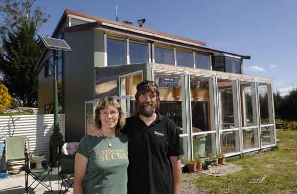 Jennie Upton and Murray Grimwood are so happy in their energy-efficient home off the Kilmog that...