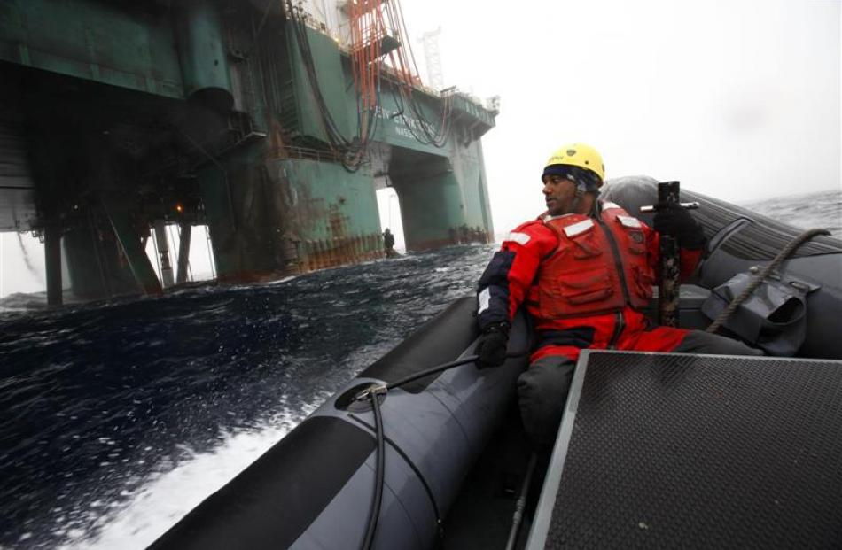 Greenpeace head Kumi Naidoo prepares to do battle last month in a Greenpeace oil protest in the...