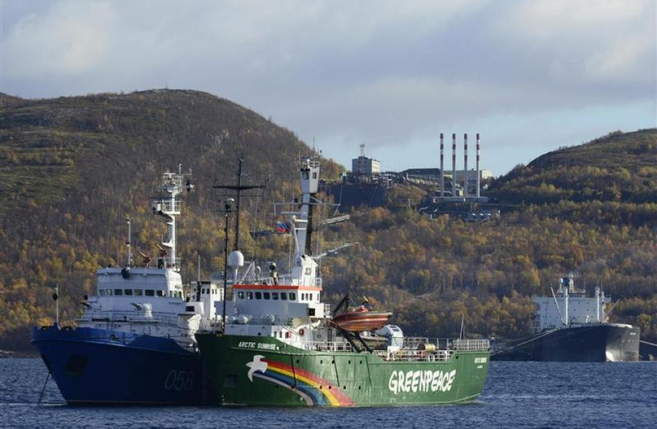 Greenpeace's Arctic Sunrise anchored outside the Arctic port city of Murmansk before protests at...