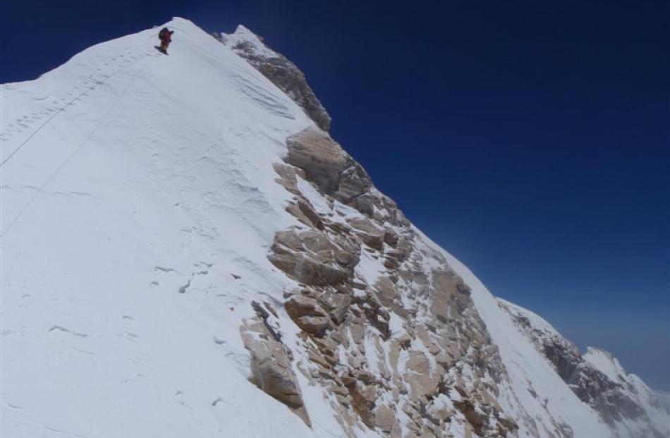 Guy Cotter leads the way to the summit of Manaslu. Photo supplied.