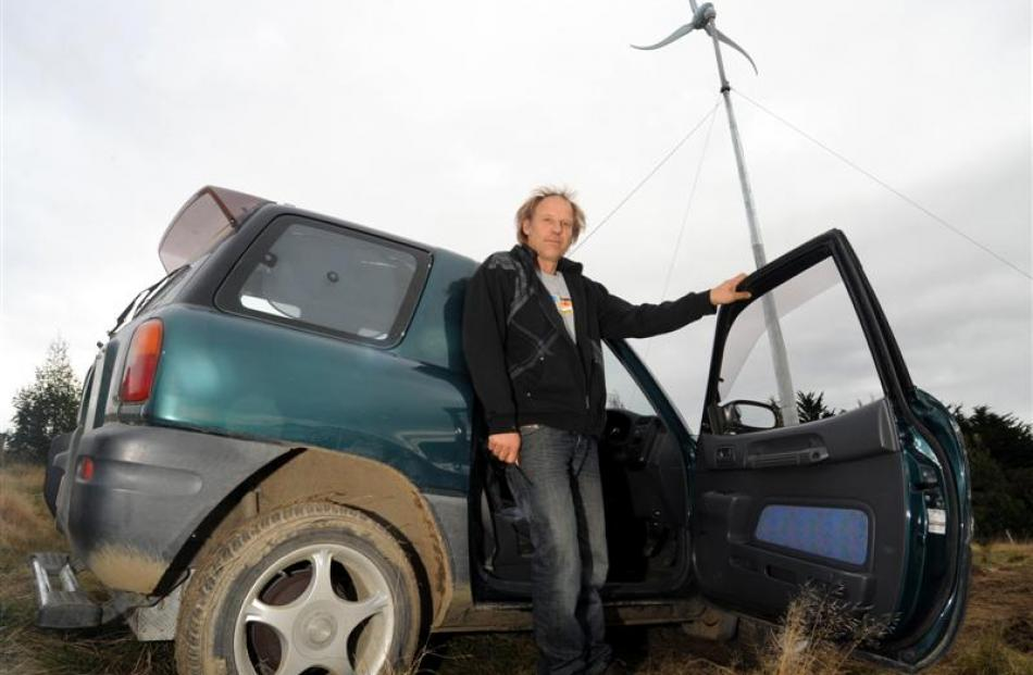 Hagen Bruggemann with his electric car and wind turbine, in Waitati yesterday. Photos by Peter...