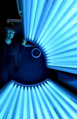 Hairhunters Hiz & Herz Salon owner Carol Uren, of Dunedin, opens a salon sunbed yesterday, which...