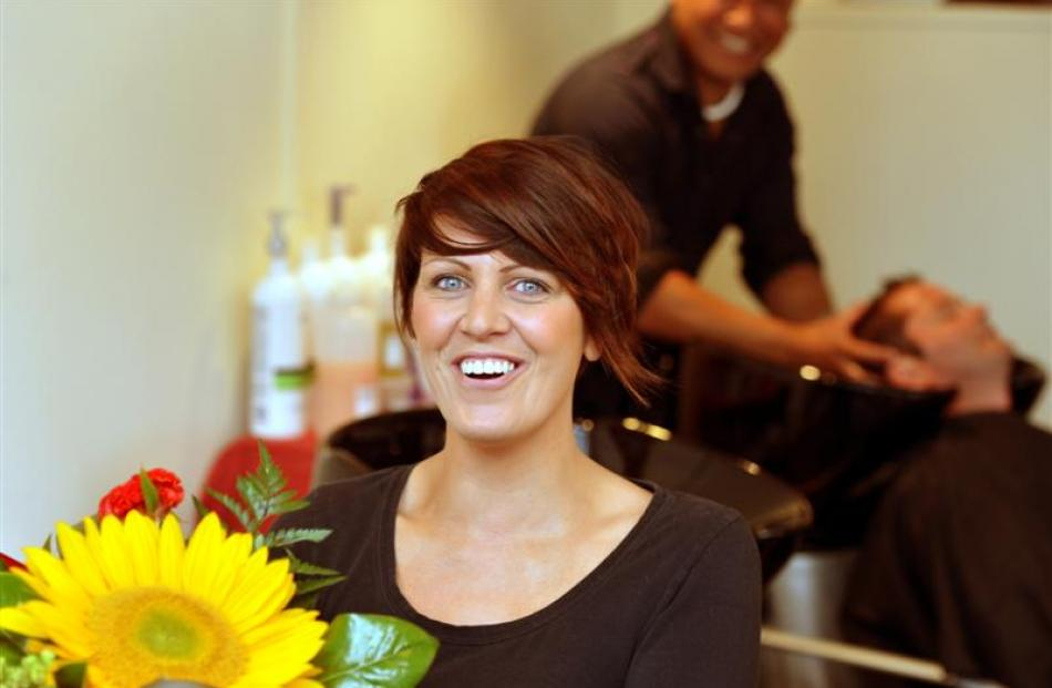 Hairworks hairdresser Kirsty Peters  is surprised by a special delivery to the salon yesterday.