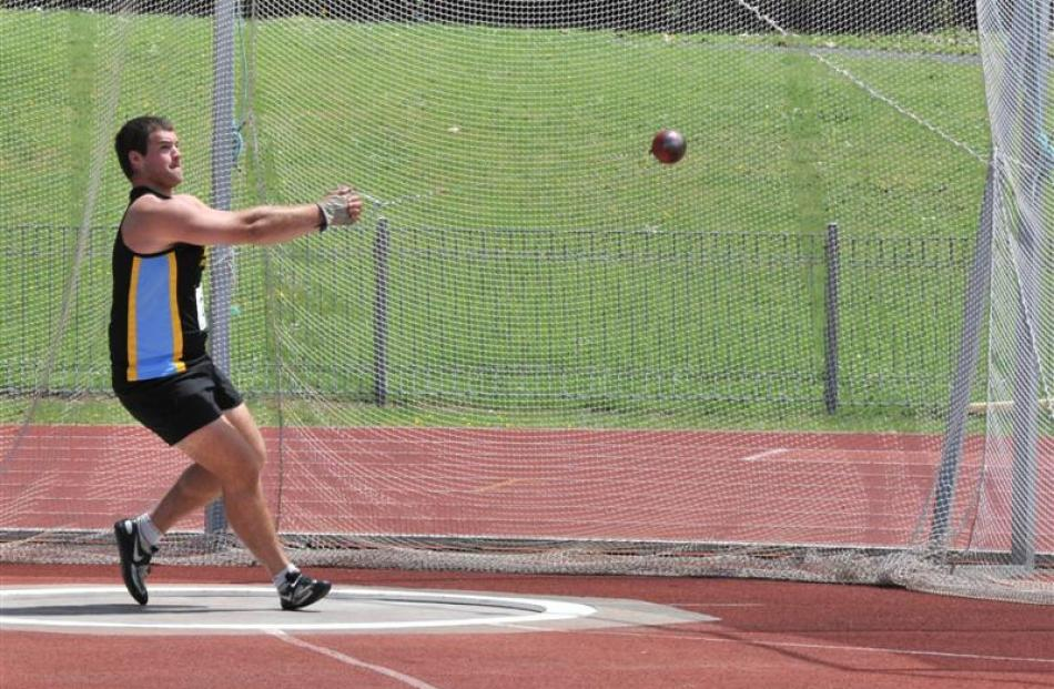 Hamish Finnie (Hill City-University) shows the form that won him the men's hammer throw at the...