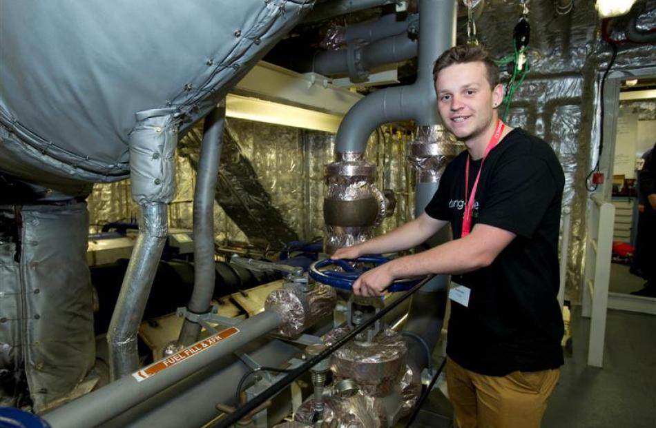 Hamish Lilley checks the engine room of  HMNZS Wellington during a recent  tour of the ship....