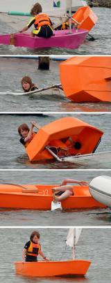 Hamish O'Malley-King goes for an unscheduled dip after capsizing his Optimist while participating...