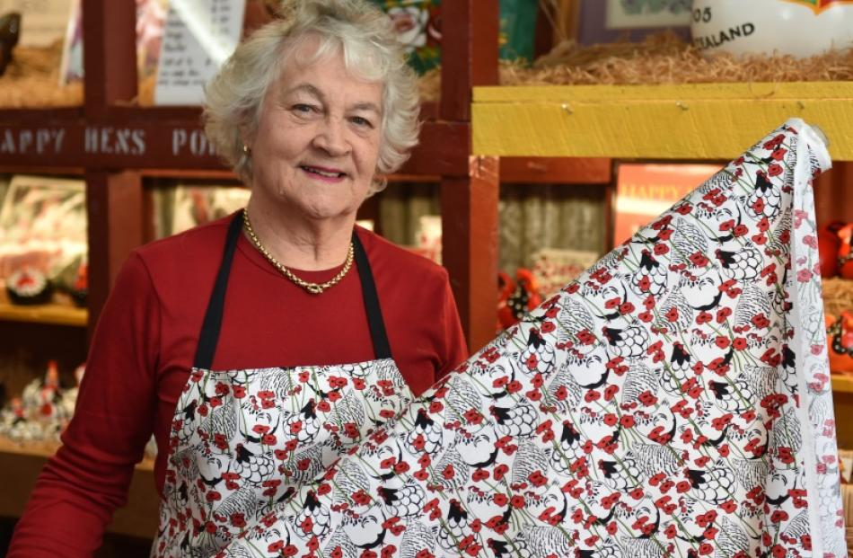 Happy Hens creator Yvonne Sutherland with her new poppy-print fabric. Photo by Gregor Richardson.