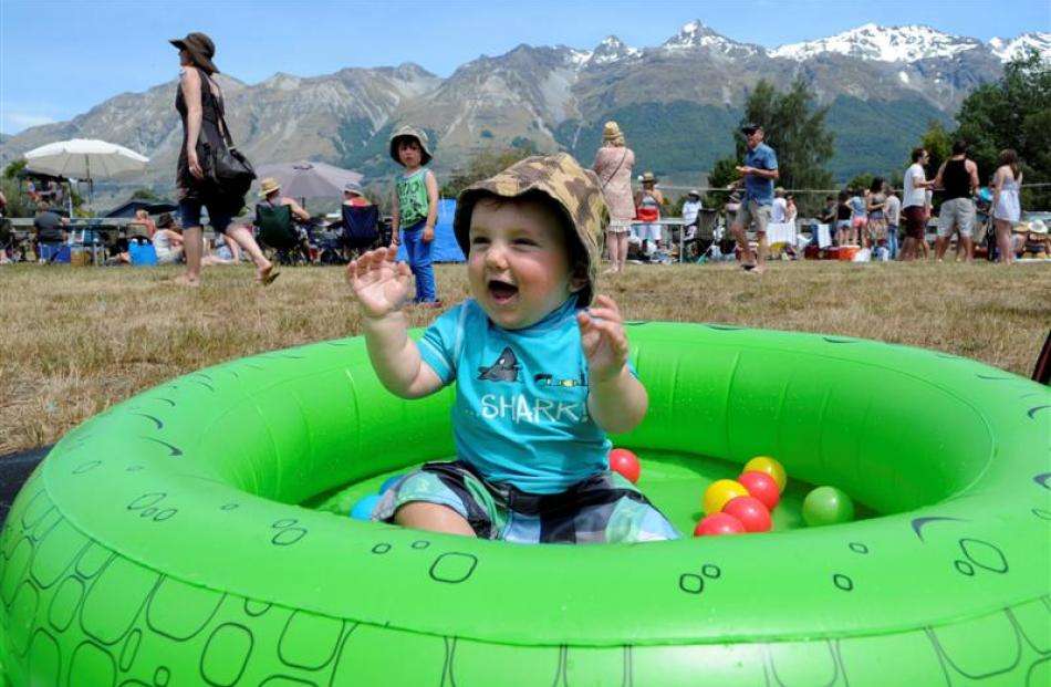Harlan Mason (10 months) of Invercargill keeps cool in a paddling pool.