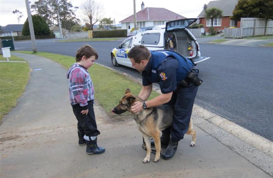 Harley Shuttleworth meets police dog handler Constable Alan Duncan and German Shepherd Brook....