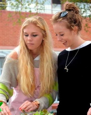 Harriet Oatley (19, left) and Jessie Mathews (18) test their skills against the competition.