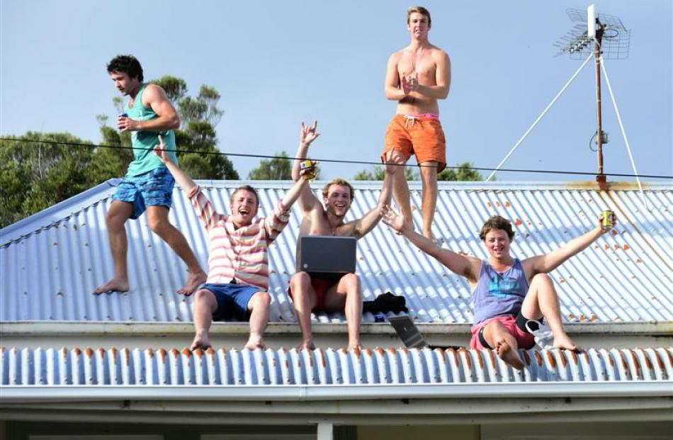 Having a blast on the roof of a Dundas St flat are (from left) Mitch Lalor (20), of Methven,...
