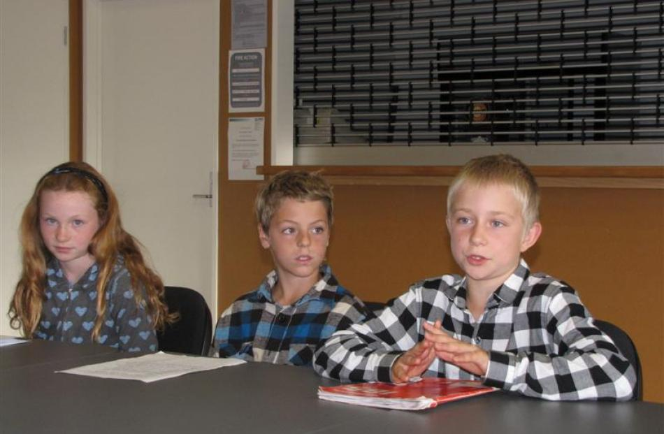 Hawea Flat School pupil Dylan Rimmer (10, right) has his say at a hearing in Lake Hawea yesterday...
