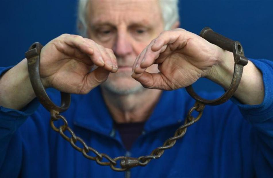 Hayward's Auction House owner Kevin Hayward holds shackles set for auction next week. Photo by...
