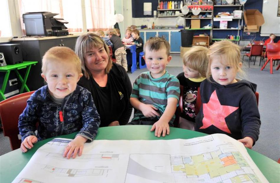 Head teacher Paula Reynolds shows plans for the new earthquake-proof building for the Mosgiel...