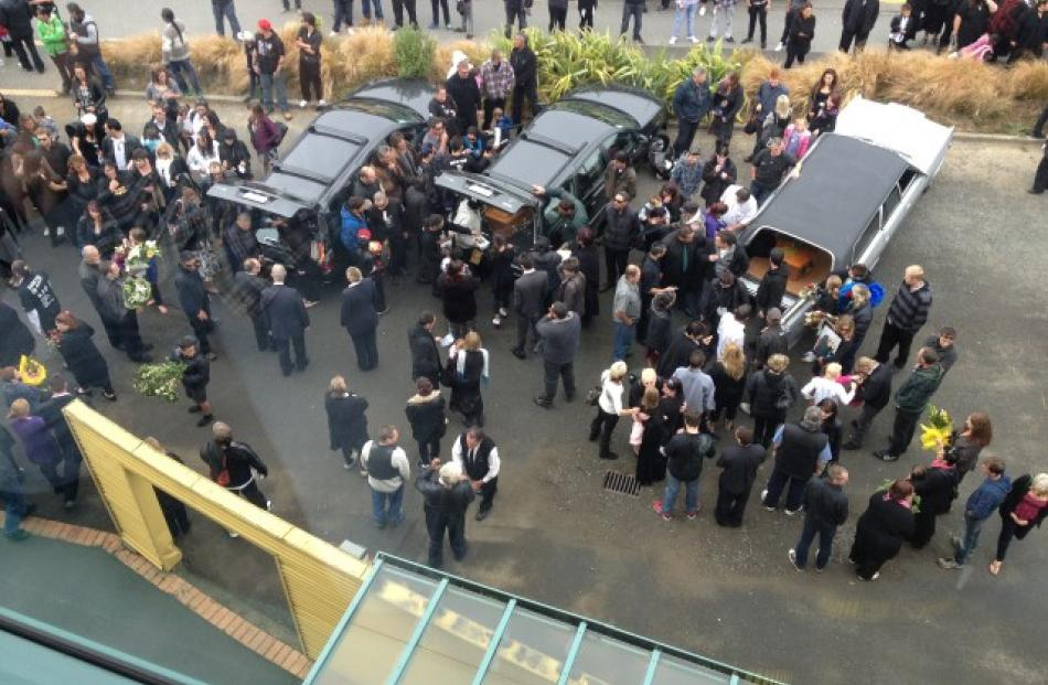 Hearses bearing coffins containing the bodies of the Easy Rider sinking victims are seen at Rugby...