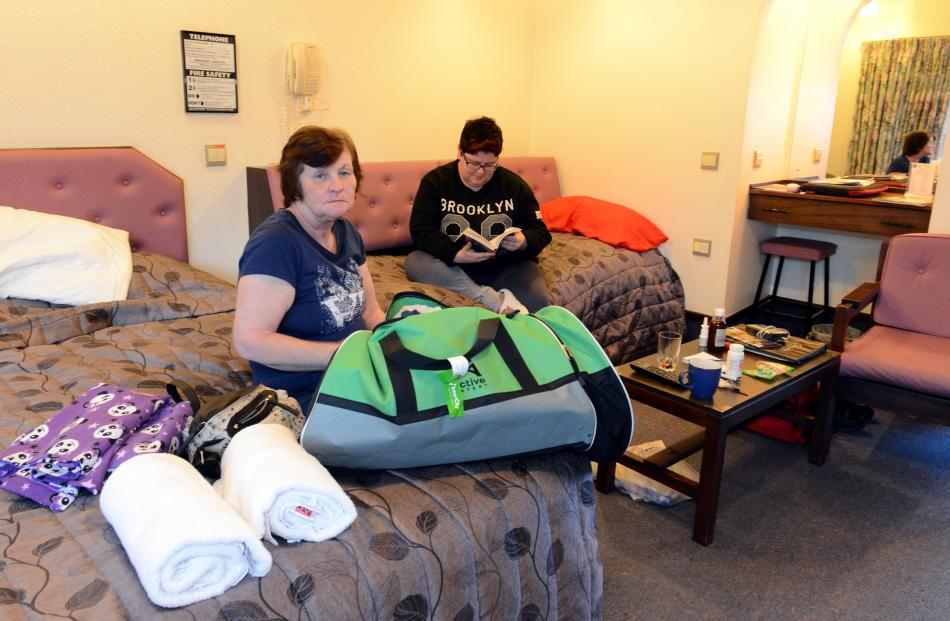 Heather (front) and Jennifer Conder, who are staying at the Alcala Motor Lodge, are unable to...