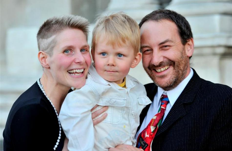 Helen, Connor (2) and Ian Martin, from Cornwall, celebrate becoming New Zealand citizens in...