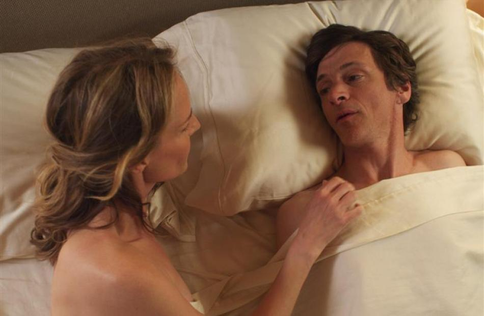 Helen Hunt, as Cheryl Cohen Greene, and John Hawkes, as Mark O'Brien, in a scene from The...