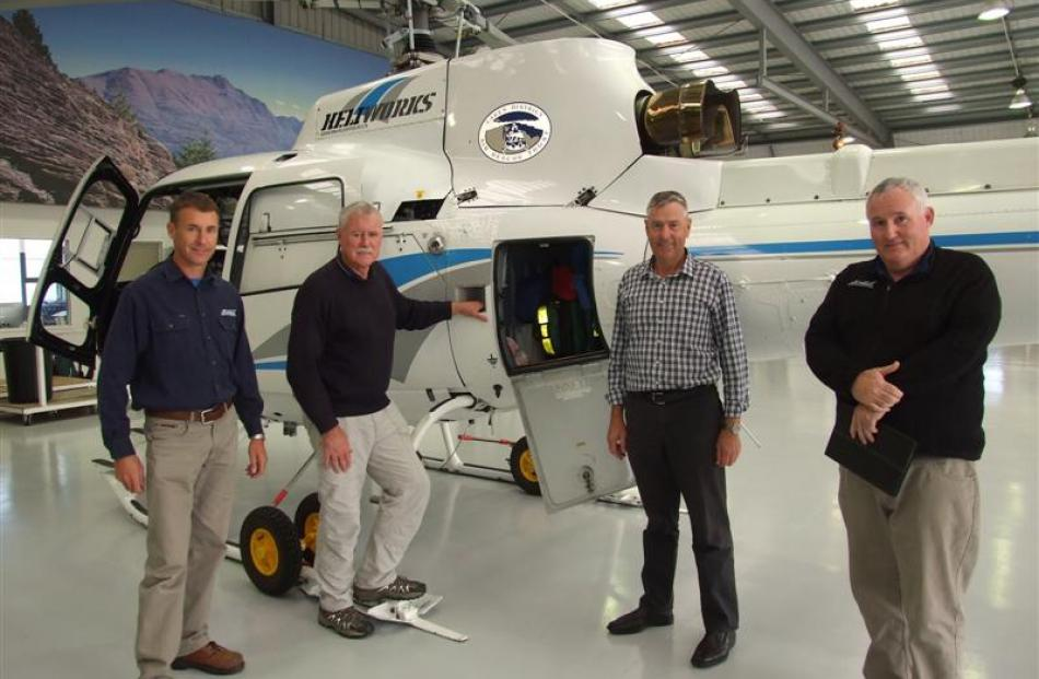 Heliworks pilot Shaun Clark (left), with (from left)  Lakes District Air Rescue Trust chairman...